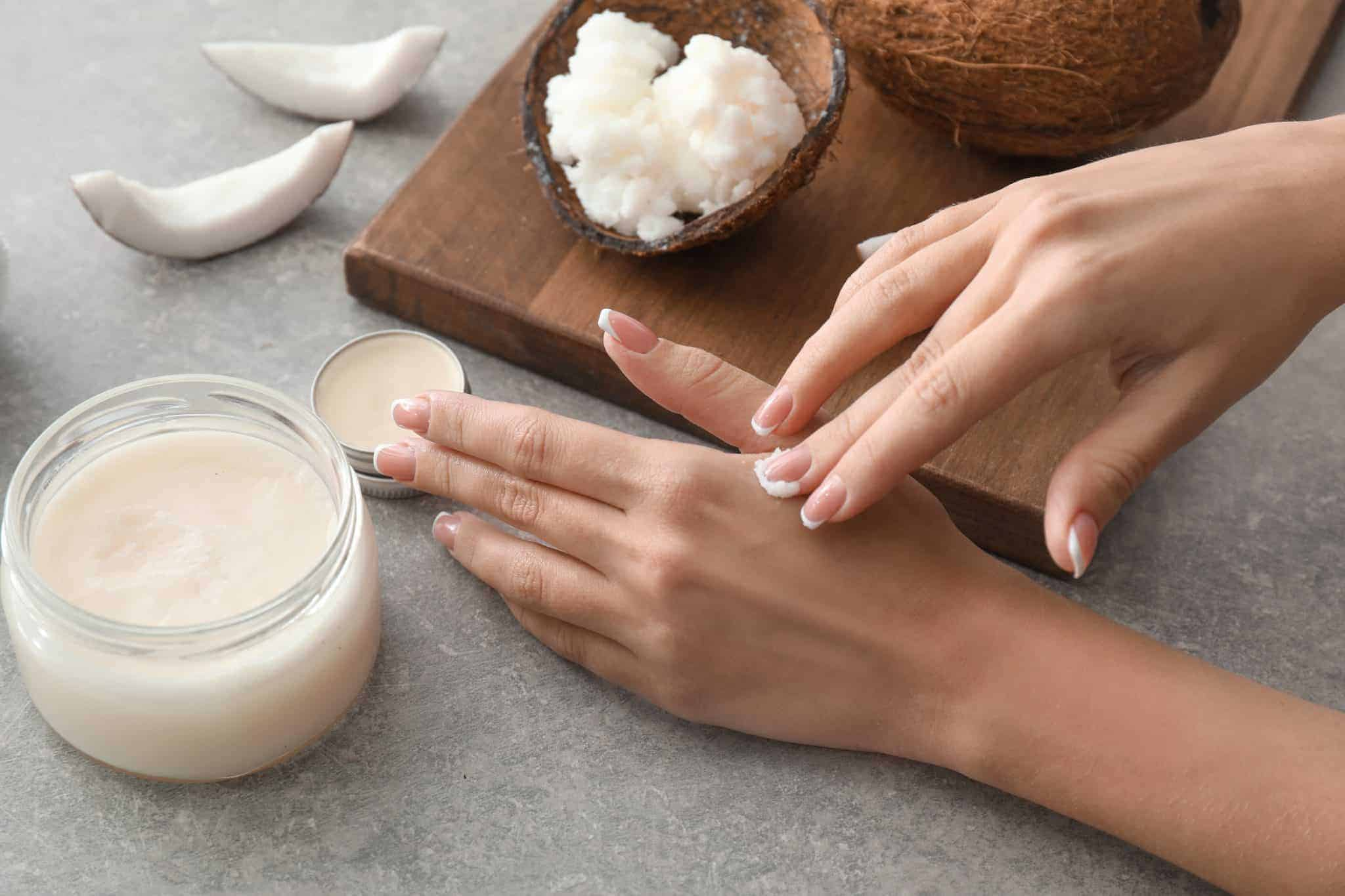 Woman spreading coconut skin care product onto skin