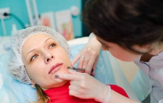 Woman receiving Acid Based Filler injection