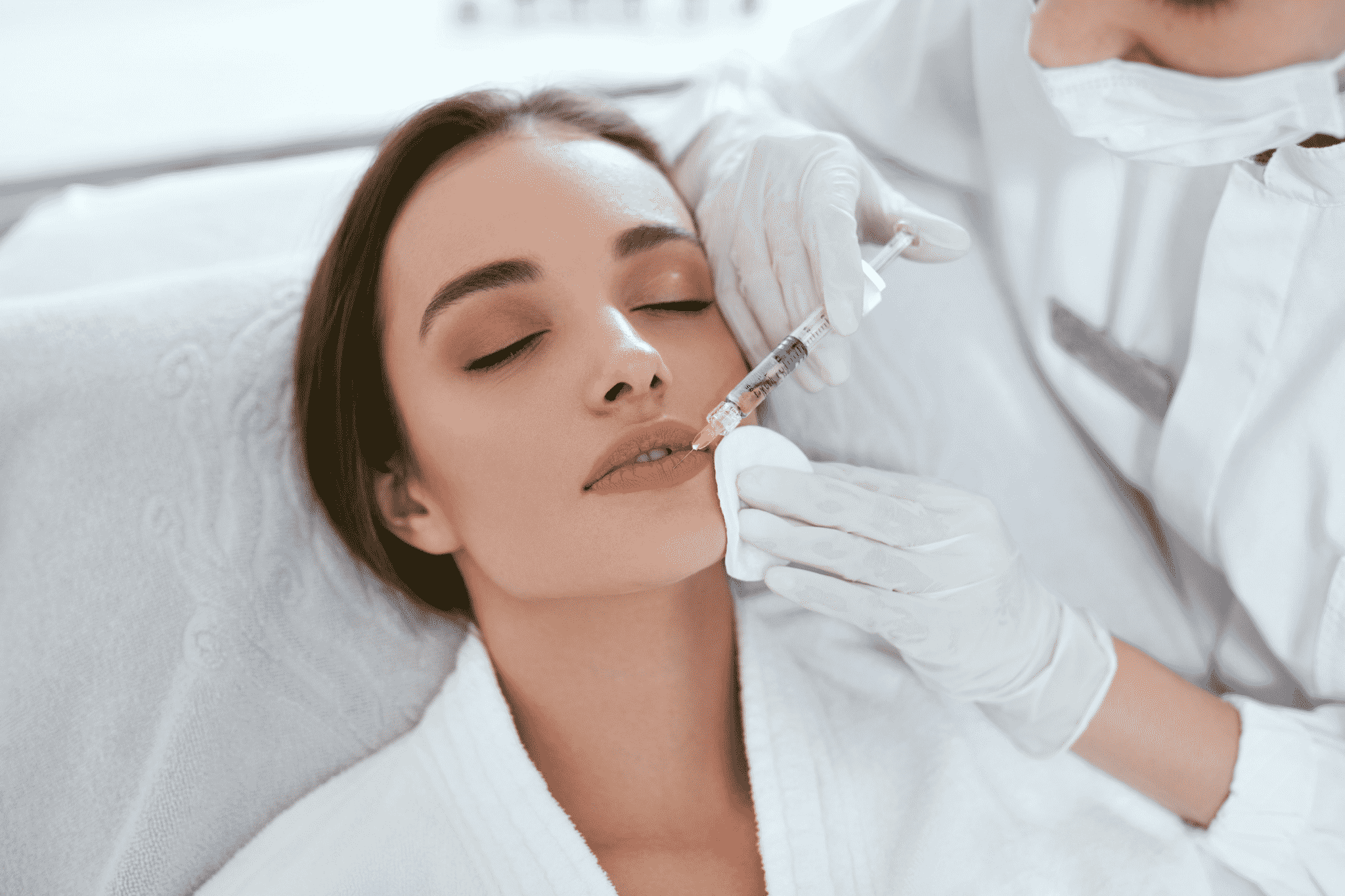 Beginners Guide 12 Things to Know Before Getting Botox or Fillers woman getting botox in her lips arcarapsychiatry.com Arcara Psychiatry
