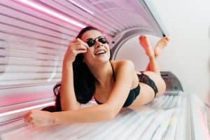 A girl using a tanning bed