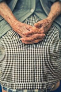 Liver spots on the hands of an older woman